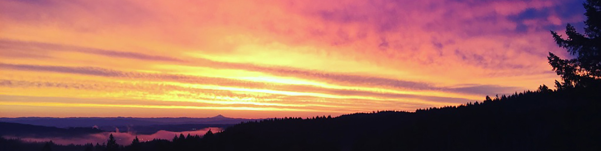 oregon sunset over the hills, mountains, water and trees; trauma healing, somatic awareness healing